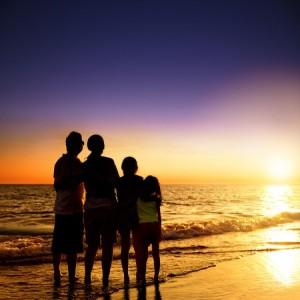 41308001 - happy family watching the sunset on the beach
