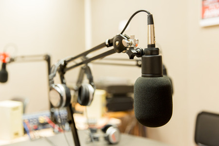 53434550 - technology, electronics and audio equipment concept - close up of microphone at recording studio or radio station