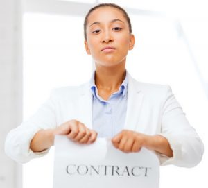 54817750 - business and office, legal concept - african businesswoman tearing contract
